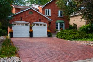 House with brick driveway
